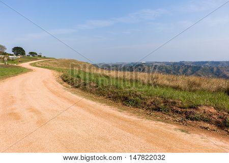 Dirt road on hillside sky rural countryside landscape
