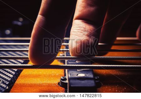 Male Fingers On A Bass Guitar
