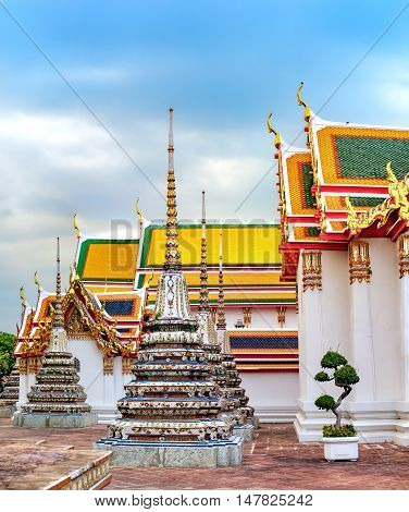 Classic Thai architecture of Wat Pho in Bangkok Thailand. Wat Pho known also as the Temple of the Reclining Buddha.