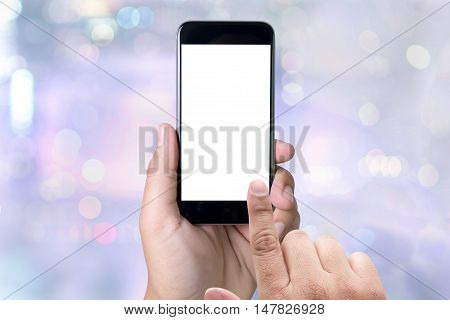 person holding a smartphone on blurred cityscape background