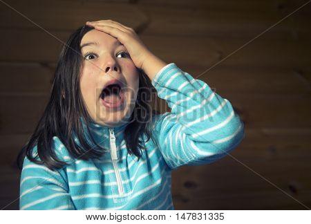Teenager girl gaping in surprise