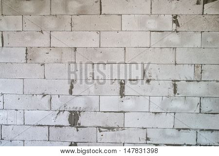 Texture of a light gray wall during overhaul