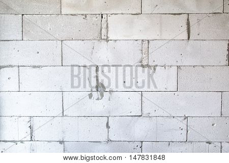 Texture of a light brick wall during overhaul