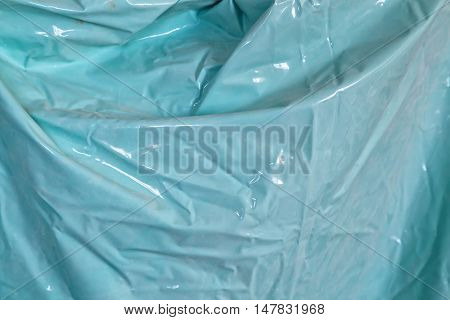 Texture of blue waterproof oilcloth or cellophane
