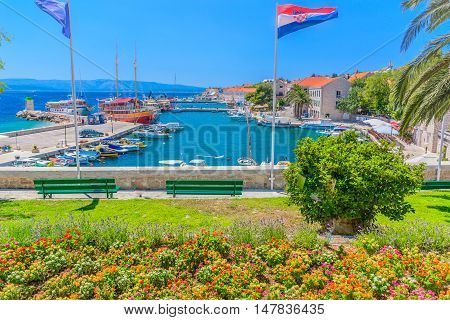 View at town center of touristic place Bol on Island Brac, Croatia summertime.