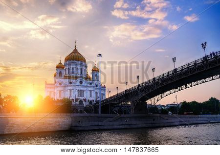 Moscow landmark. Moscow sunset view of Moscow architecture landscape - Cathedral of Christ the Saviour and Patriarshy bridge in sunset in Moscow Russia. Summer view of Moscow architecture landmark.