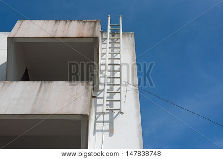 exterior of building with the fire escape.blue sky background