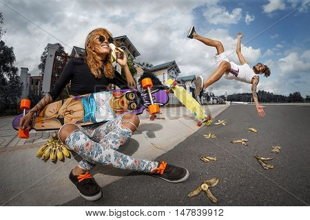 Girl eating banana and Guy on banana slip