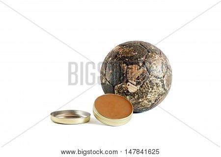 Can of handball wax near a dirty handball ball isolated on white