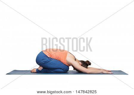 Beautiful sporty fit yogini woman practices yoga asana balasana (child's pose) - resting pose or counter asana for many asanas in studio isolated on white