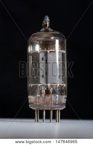 Preamplifier vacuum tube against dark background