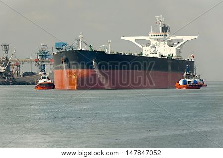 Large crude oil tanker ship coming into port