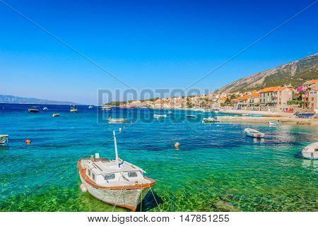 Waterfront view at famous touristic destination town Bol, Island Brac, Croatia.