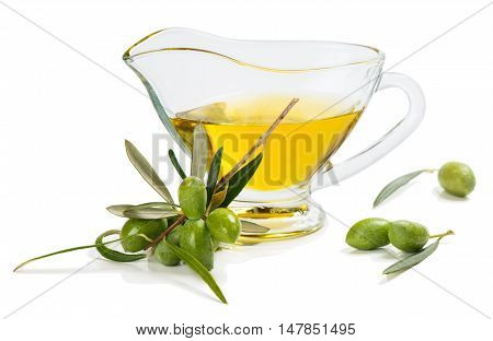 Branch with green olives and sauceboat of olive oil isolated on white background.