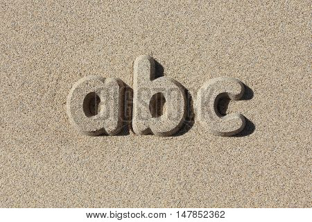 Abc written in sand letters. Simple and graphic.