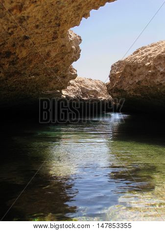 Pools of water within open geological cracks in the land caused by earthquake in Ras Muhammad national park