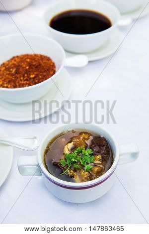 Fish maw soup in bowl on white table