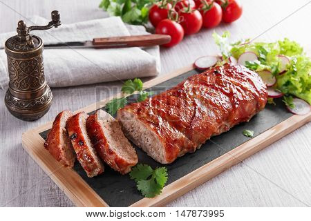 baked bacon wrapped meatloaf with salad a