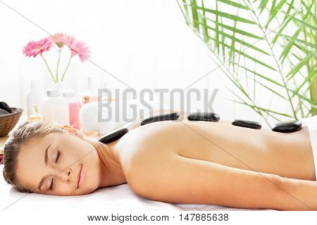 Portrait of a Woman Getting a Hot Stone Massage