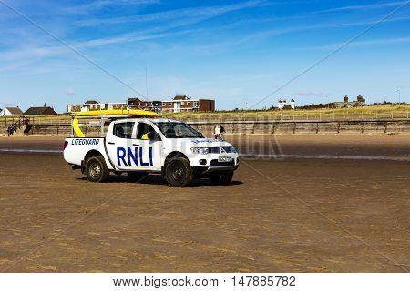 CROSBY BEACH, ENGLAND - SEPTEMBER 17: RNLA truck on a beach near Liverpool, England on September 17, 2016.