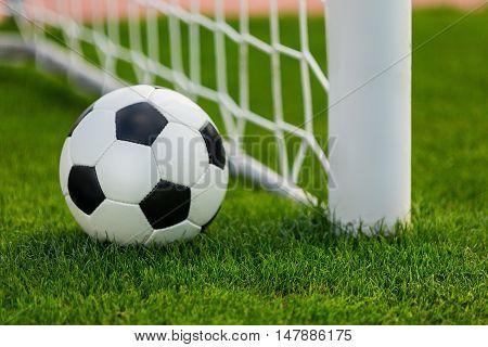 Closeup of a Soccer Ball and Goalpost