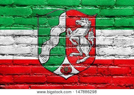 Flag Of North Rhine-westphalia With Coat Of Arms, Germany, Painted On Brick Wall