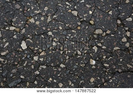 nice ground on the topic - the road, stones, cracks in the ground natural patterns