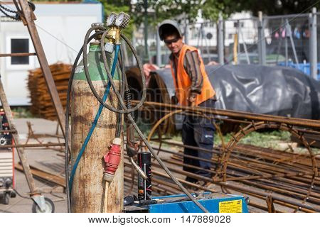 Unidentified Workers Working With Concrete Iron At A Construction Site