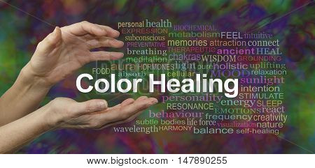Color Healing Therapy Website Banner  -  Female hands sensing the words COLOR HEALING surrounded by a relevant word cloud on a multicolored background