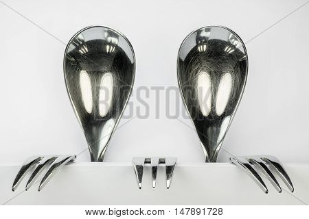 Metal spoons and three forks formed into two conceptual fantasy figures
