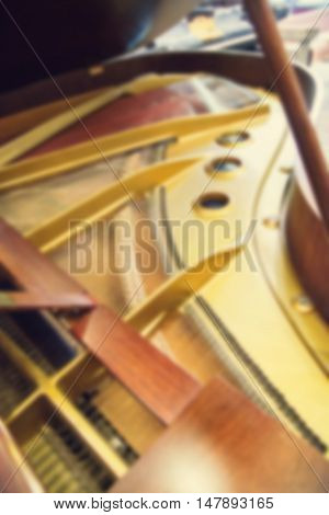 blurred piano in a music store . .