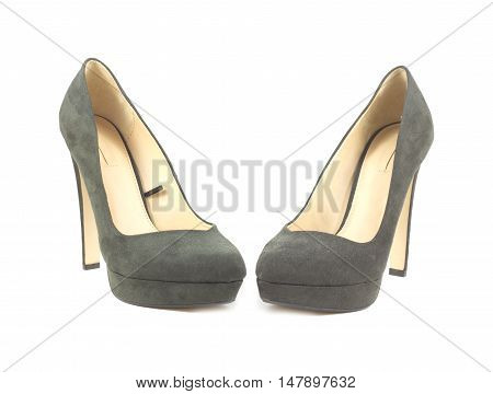 Two beautiful female suede shoes with high heel isolated on white closeup