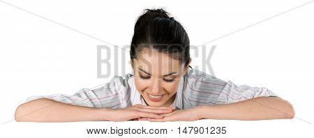 Woman with folded arms looking down on a blank surface