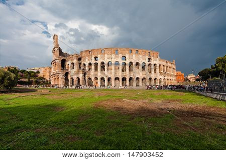 Rome, Italy - September 12, 2016: Tourists visiting one of the famous sightseeing and monument in the world - Colosseum in Rome