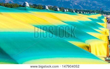 Row of colorful umbrellas on a Mediterranean beach. Ionian Sea Calabria. Italy