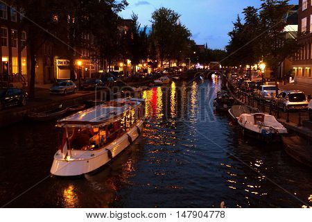 Boats and Lights on a Canal at Twilight