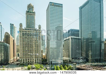 Chicago, USA - May 30, 2016: View of Wacker Drive with bridge, skyscrapers, people and cars in downtown.