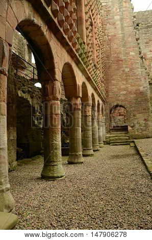 A view of the supporting columns and arches under the façade in Crichton castle