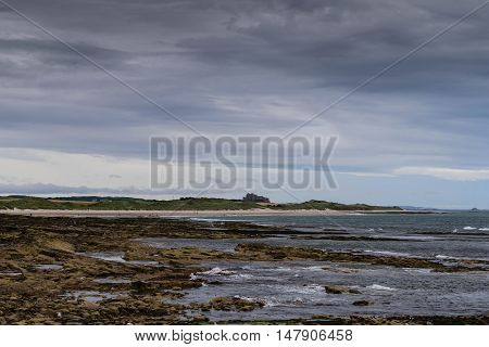 The coast of Seahouses, England with Bamburg Castle in the distance.