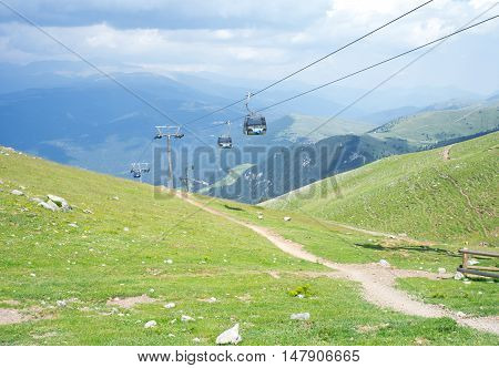 Spectacular top panoramic view of the Pyrenees mountain ridge and beautiful clouds and cable car from the peak of Tosa d'Alp, Pyrenees, Girona, Alp, Catalonia, Spain