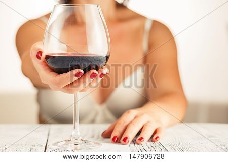 female portrait drinking red wine from glass