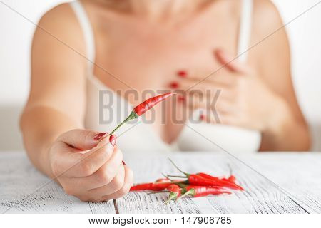 Woman With Small Red Hot Peper