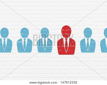 Business concept: row of Painted blue business man icons around red business man icon on White Brick wall background