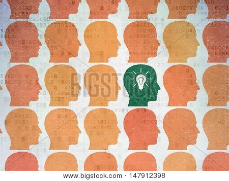 Business concept: rows of Painted orange head icons around green head with light bulb icon on Digital Data Paper background