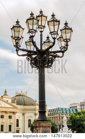 Old-fashioned city street lamp in the nigt. Gendarmenmarkt in Berlin, Germany