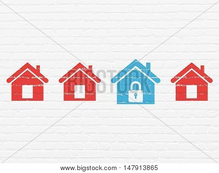 Privacy concept: row of Painted red home icons around blue home icon on White Brick wall background