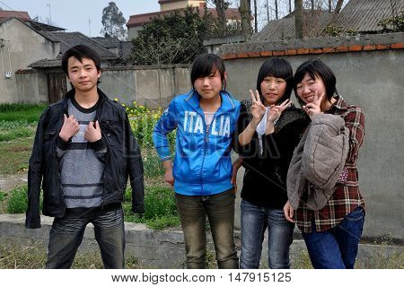 Jiu Chi Town China - February 27 2010: Chinese teenagers flash the