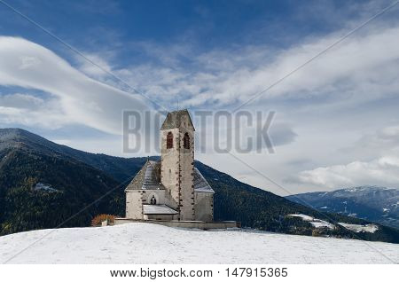 The church of St. Jakob (San Giacomo) near St. Magdalena (Santa Maddalena) in the Villnoesstal (Val di Funes valley) in South Tyrol in Italy in the snow in winter.