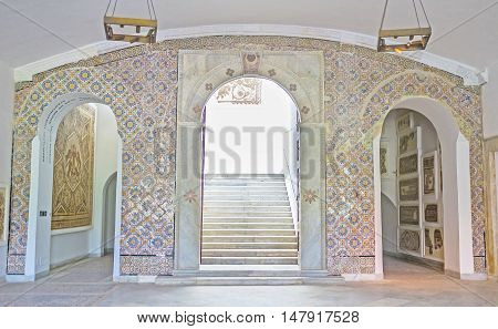 TUNIS TUNISIA - SEPTEMBER 2 2015: The hall of Bardo National Museum decorated with arched passes covered with tiles on September 2 in Tunis.