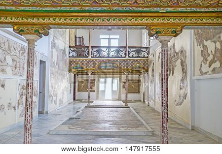 TUNIS TUNISIA - SEPTEMBER 2 2015: The Althiburos Room of Bardo National Museum with the slender stone pillars and ancient mosaic on the walls and floor on September 2 in Tunis.
